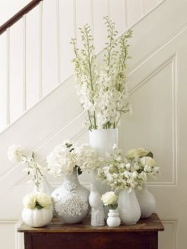All white - different flowers with different vases